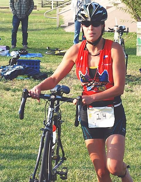 Lucy Rice, the 2013 women's overall Dust Devil Triathlon winner, takes off on the bike portion of the race on Saturday.