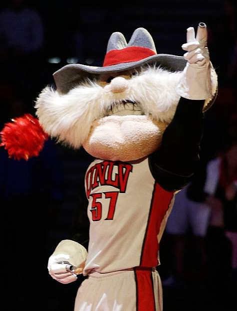 """FILE - In this Feb. 1, 2014, file photo, UNLV mascot Hey Reb warms up the crowd before an NCAA college basketball game in Las Vegas. UNLV President Len Jessup says the school needs to keep """"Rebels"""" as its nickname after new research concluded it is not a reference to the Confederacy. (AP Photo/Isaac Brekken,File)"""