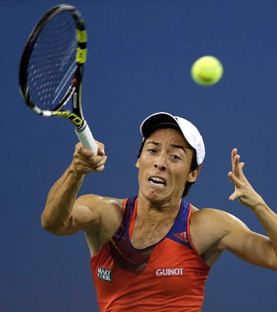 Francesca Schiavone, of Italy, returns to Serena Williams, of the United States, during the first round of the 2013 U.S. Open tennis tournament, Monday, Aug. 26, 2013, in New York. (AP Photo/Charles Krupa)