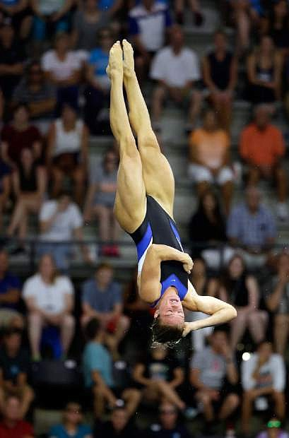 Katrina Young performs a dive during the women's 10-meter platform final at the U.S. Olympic diving trials in Indianapolis, Saturday, June 25, 2016. (AP Photo/Michael Conroy)