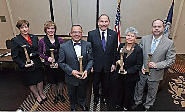 Honored in Washington, D.C., at the opening of the National Association of State Directors of Veterans Affairs conference are, from left to right, Kat Miller, director of Nevada Department of Veterans Services; Tina Richardson, Michigan Veterans Affairs Agency; Dr. Vito Imbasciani, secretary of Department of Veterans Affairs; Bob McDonald, Department of Veterans Affairs secretary; Lourdes E. Alvarado Ramos, director of Department of Veterans Affairs;  and Lonnie Wangen, commissioner of North Dakota Department of Veterans Affairs.