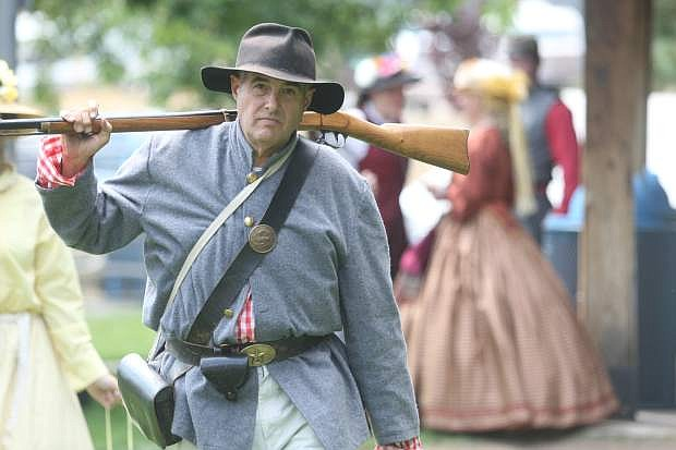 Dave Wilson of Sacramento returns to the Civil War camp following the battle in Virginia City  last year .
