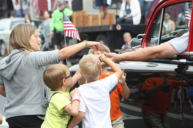 Children reach for candy at the annual Virginia City Labor Day parade on Monday.