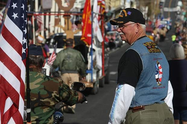 Fernley resident and Viet Nam war veteran Harry Wheeler watches the Veterans Day parade in Virginia City on Monday.