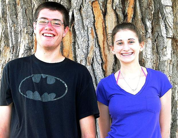 Joseph Jamieson and Madellyn Christie give big smiles Wednesday afternoon during Churchill County High School's senior class picnic at Oats Park after finding out Christie was named valedictorian and Jamieson was salutatorian for the CCHS class of 2015.