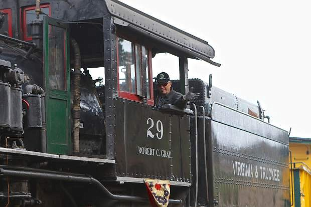 Clifford 'Chooch' Cox pulls the #29 V&T engine into the station Saturday in Virginia City. The Virginia and Truckee Railroad opened its season Saturday in Virginia City.