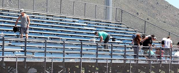 About 25 Douglas High School students volunteered to help remove spray paint from the Carson High School football and track stadium.