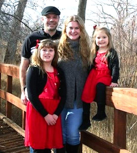 The Smith family posed for a Christmas picture. From left are Becca, front, Jeff, Megan and Lauryn.