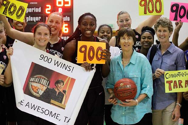 In this image provided by Plan BC3, Stanford coach Tara VanDerveer, third from right, poses with her players after their 83-59 win over Florida Gulf Coast in an NCAA college basketball game Wednesday, Nov. 27, 2013, in Puerto Vallarta, Mexico. VanDerveer became the fifth women's coach to reach 900 victories with Wednesday's win.  (AP Photo/Plan BC3, Casey Murphy)