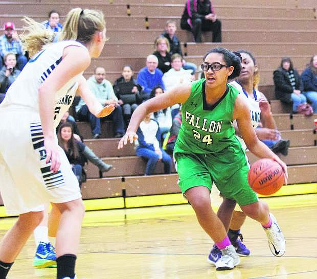 Leta Otuafi, right, and the Lady Wave basketball team rallied to defeat Damonte Ranch on Monday.