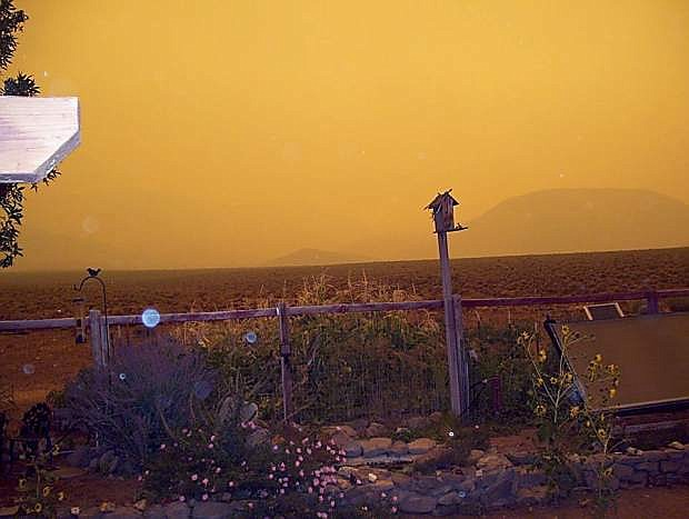 The sun is seen through the smoke from the Gardnerville Ranchos on Thursday afternoon.
