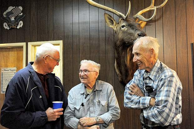 Wally Bennett, left, Don Lane and Dick Lane visit during the 151st  anniversary of the founding of Warren Engine Company #1. The company is believed to be the oldest continuously operating volunteer fire department on the West Coast. The annual business meeting and dinner was held at the Eagles Lodge in Carson City Tuesday June 17, 2014. Bennett joined the department in 1966, Don Lane joined in 1965 and his brother Dick  joined in 1962.