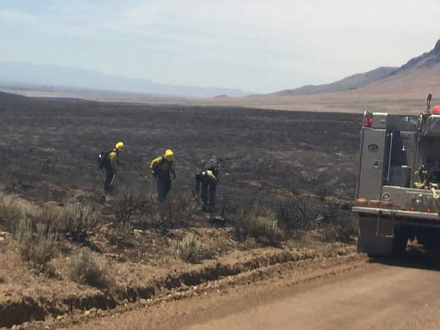 Fire crews tend to hot spots Monday, July 4, 2016 on the perimeter of a wildfire that has consumed 185 square miles of rangeland in north-central Nevada. More than 250 crew members were fighting the blaze that burned within a few hundred yards of ranch homes near the town of Midas about 35 miles north of Battle Mountain, but there have been no reports of injuries or structure damage. (Rudy Evenson/ U.S. Bureau of Land Management via AP)