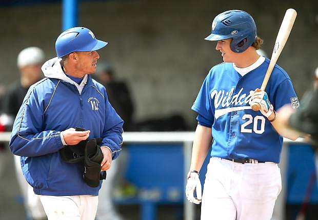 Western Nevada College's head coach DJ Whittemore talks with Cody Reynolds during a game against the College of Southern Idaho at John L. Harvey Field in Carson City last season.