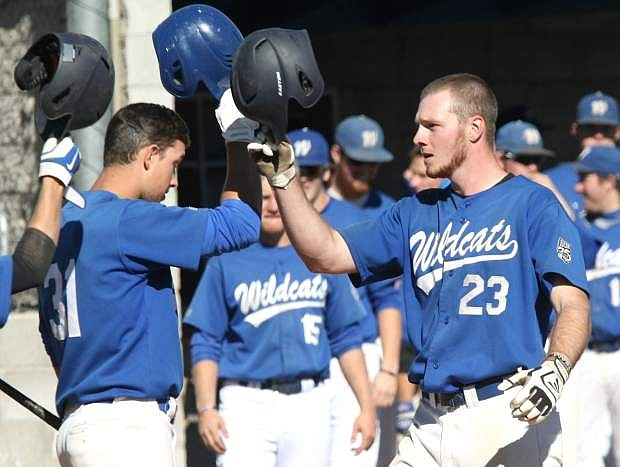 Corey Pool is congratulated by his teammates at home plate after hitting a solo home run in the 5th inning against Sierra College on Tuesday.