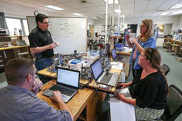 From left front, Matt Anderson, Brendan Buckley, Professor Emily Howarth and Lindsay Moore work in the industrial technology labs at Western Nevada College.