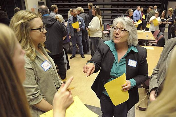 From left, Geri Pope-Maddox, Carson McFadden and Kim Desroches talk about ways to remember people's names during a Western Nevada College Business Association networking social Thursday, Jan. 21, 1016 at WNC. The event, part of the association's employment preparation series, provides education, networking and community exposure to participants.
