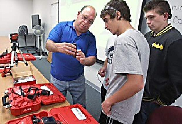 Instructor Robert Ford demonstrates a laser level to a group of Silver Stage High School students during a Careers in Construction Month event at Western Nevada College on Friday.