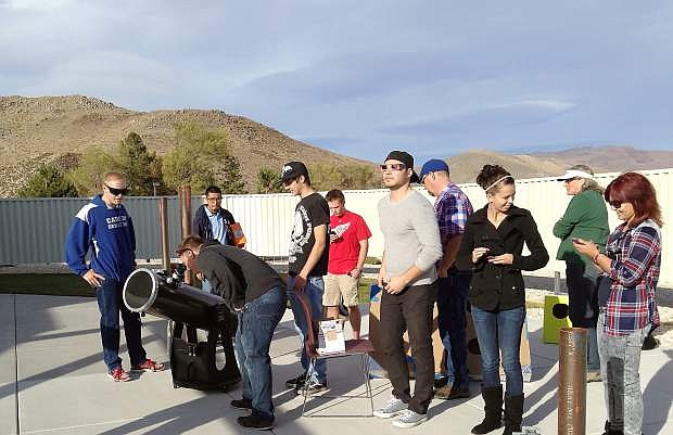 WNC students view a partial solar eclipse using one of the telescopes at the Jack C. Davis Observatory.