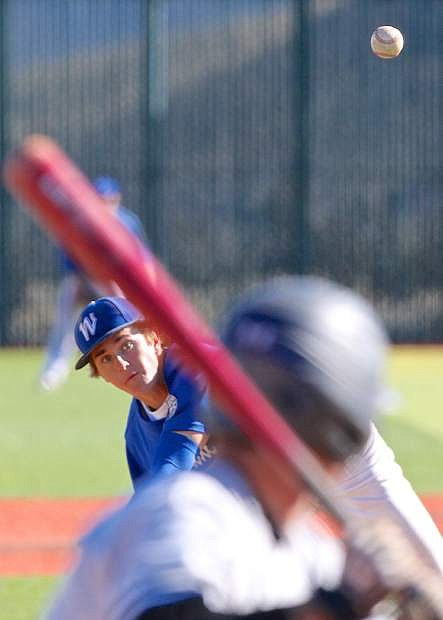 Wildcat pitcher Matt Young fires one from the mound during a game against College of Southern Idaho last season at WNC.