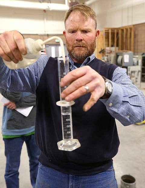 Mitch Burns, with Lumos and Associates, demonstrates soil testing techniques in a Construction Management class at Western Nevada College in Carson City, Nev., on Monday, Feb. 9, 2015.