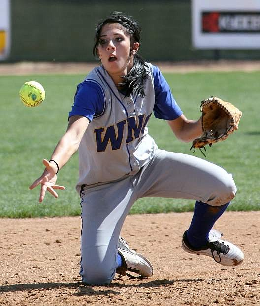 Madison Gonzalez flips the ball to second to record a force out during a game in 2013.