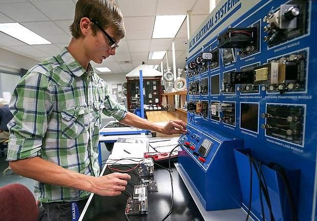 Western Nevada College student CJ Straw builds and tests an electrical circuit in the Applied Industrial Technology program hands-on lab class.