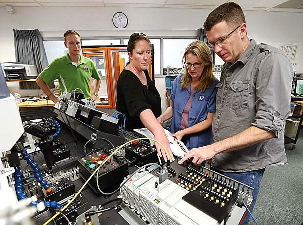 From left, Brendan Flayer, Lindsay Moore, Professor Emily Howarth and Matt Anderson work in the industrial technology labs at Western Nevada College in Carson City last fall.