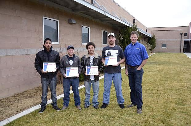 Western Nevada College students, from left, Luis Pacheco, Michael Atkinson, Devin White and Jeremy Taylor earned Auto Service Excellence certifications after taking Automotive Mechanics classes from instructor Jason Spohr, right. Atkinson was one of four students to pass all nine certification exams.