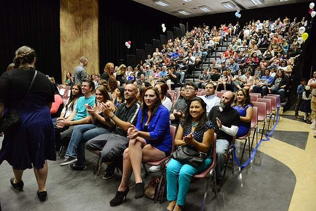 Students applaud their comrades as they file in for Friday evening's Western Nevada College Adult Literacy and Language graduation ceremony in Aspen Building.