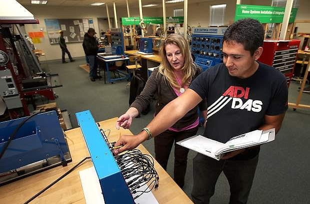 Professor Emily Howarth and Joaquin Garcia work in the AIT lab at Western Nevada College on Nov. 4, 2013.