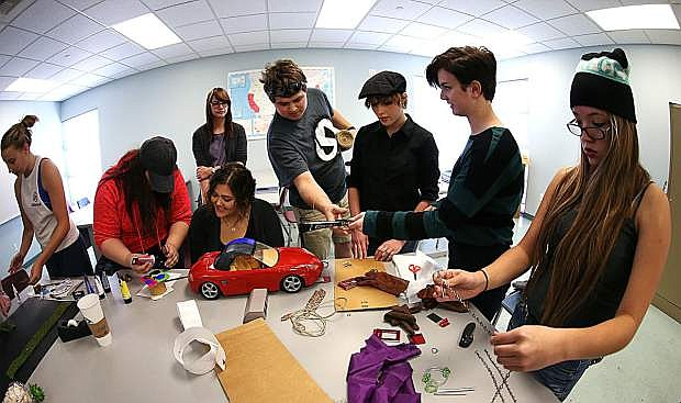 Students in a Western Nevada College English class create a Steampunk time machine as part of their studies on Oct. 12.