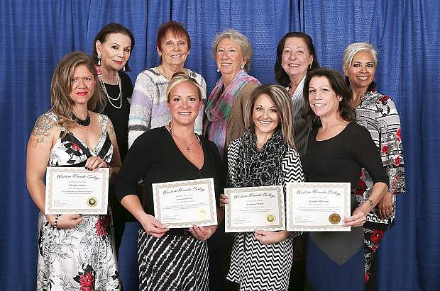 Scholarship recipients, front row from left, Heather Palmer, Amanda Peachay, Stephanie Pruitt and Jennifer McCoun are honored by the Carson Tahoe Health Auxiliary at the Western Nevada College Scholarship Night event, in Carson City, Nev., on Friday, Nov. 14, 2014. Donors, from left rear, include Judith Cordia, Sam Allec, Barbara Noland, Meri Ellis and Elizabeth Abarca-Angel.
