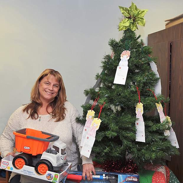 Nursing Professor Deborah Ingraffia-Strong stands next to the department's Angel Tree on the campus of Western Nevada College.