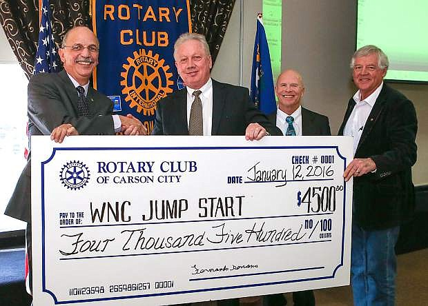From left, Rotary President Francisco Serrano, Western Nevada College President Chet Burton, John Kinkella, WNC dean of Student Services, and Larry Goodnight, acting director of the WNC Foundation, accept a check from the Rotary Club of Carson City at the Carson Nugget in Carson City on Tuesday. The organization donated $4,500 to WNC's Jump Start College program which offers high school students the opportunity to earn up to a two-year Associate Degree before graduating from high school.