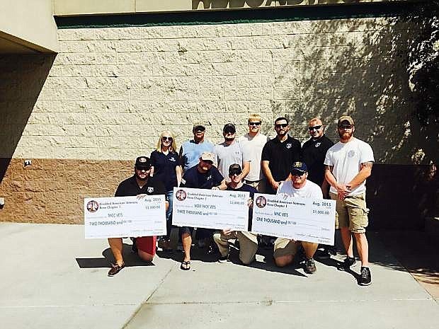 Area veterans from Western Nevada College, Truckee Meadows Community College and the University of Nevada, Reno accept scholarship checks from the Disabled American Veterans Chapter No. 1 in Reno.