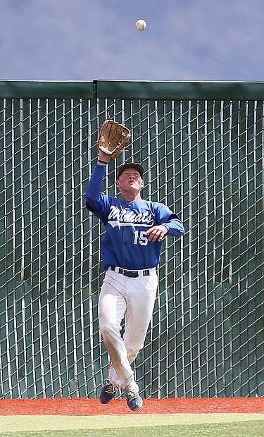 Western Nevada College's Jake Bennett makes a catch against the College of Southern Nevada during a college baseball game at John L. Harvey field, on Sunday, April 27, 2014, in Carson City, Nev.