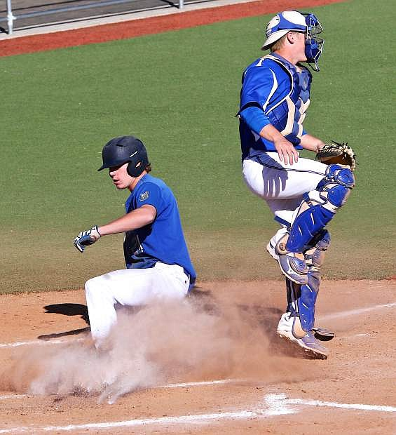 Broagan Secrist slides past the Salt Lake catcher to score the 2nd run of the game for the Wildcats Friday.