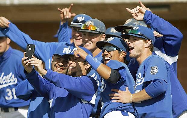 Western Nevada College players celebrate their tournament championship in West Jordan, Utah.