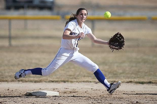 Western Nevada's shortstop Jennifer Rechel of Fallon tracks down a pickoff throw during a college softball game in February against Colorado Northwestern Community College in Carson City.