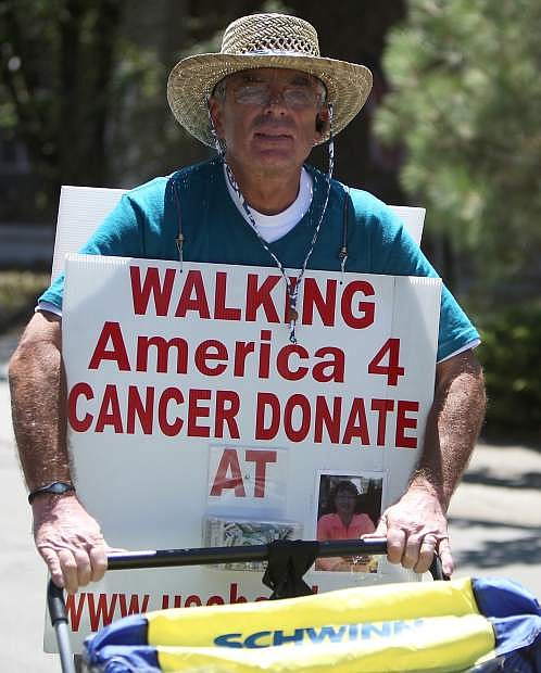 Mike Warren, who is walking across American in support of cancer research and education, made his way through South Lake Tahoe on Tuesday. He was set to be in Carson City on Wednesday night.
