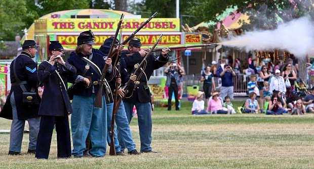 Union soldiers from the 2nd US Light Artillery fire on the Confederates Saturday at Mills Park.