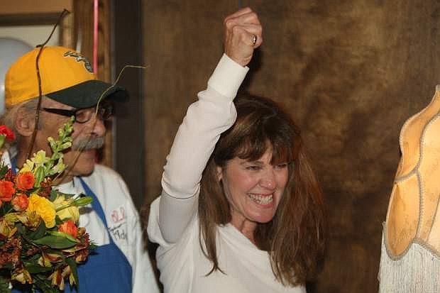 Karen Abowd celebrates election results with her husband Charlie and her supporters on Tuesday night.