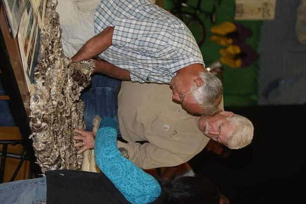 Tim Stevenson, left, and Henry French examine a rabbit pelt blanket at a presentation on Washoe history and culture.