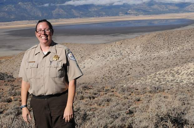 Park Supervisor Jennifer Dawson stands in front of a very dried-up Washoe Lake.