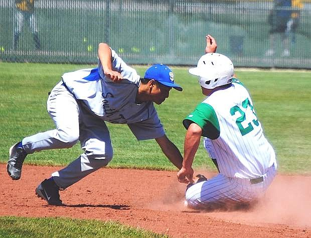 Fallon's Marshall Coverston beats the tag by South Tahoe catcher Christian Coats during Saturday's third game of the Northern Division I-A play-in series at the Ed Arciniega Complex. Fallon won, 5-4, and plays Lowry on Friday in the regional tournament in Winnemucca.