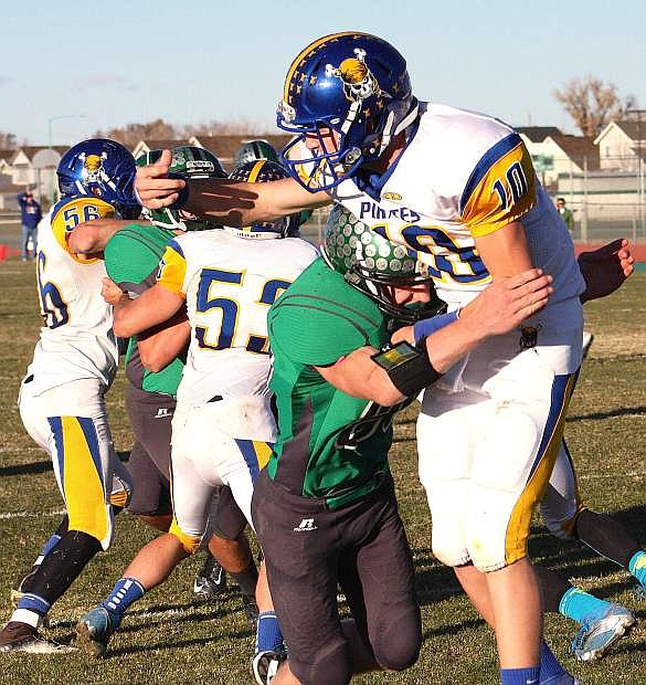 Fallon linebacker hits Moapa Valley quarterback Zach Hymas during the Wave's 34-24 win over the Pirates in the Division I-A state semifinal on Saturday at the Edward Arciniega Complex.