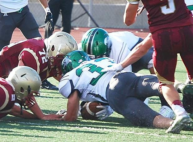 Fallon's Riley Williams (33) recovers a fumble by Cardinal Newman during Saturday's 56-32 loss.
