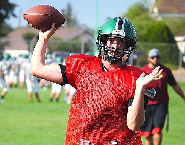Fallon senior quarterback Morgan Dirickson throws a pass during Wednesday's practice. The Greenwave are scheduled to play Wooster at 7 p.m. today at the Edward Arciniega Complex.