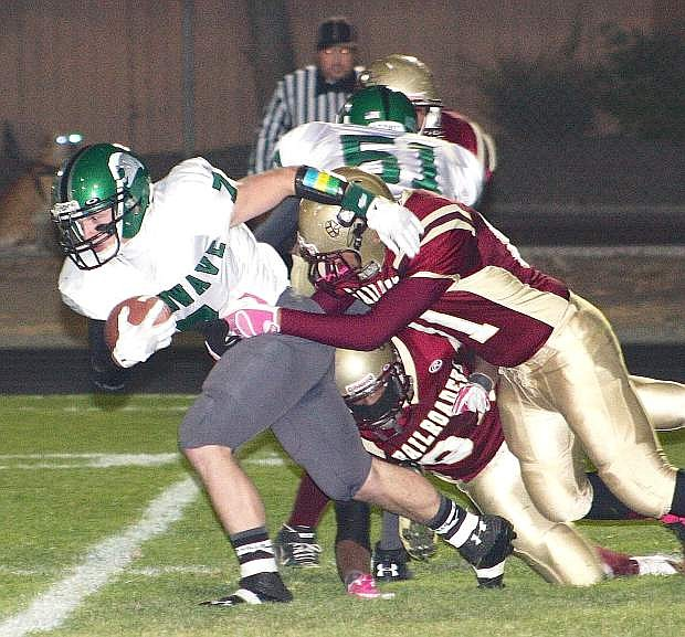 Fallon running back Trent Tarner tries for extra yardage against Sparks on Friday. The Greenwave won, 47-6.